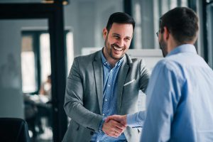 Young manager says welcome to customer