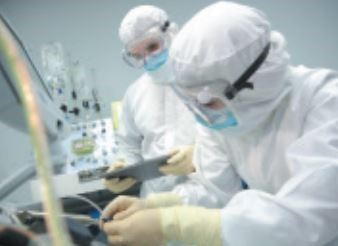 scientists in the lab with a bioreactor