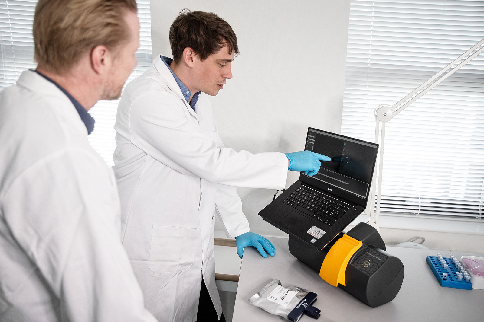 NucleoCounter® NC-202™ automated cell counter used by two scientists in the lab